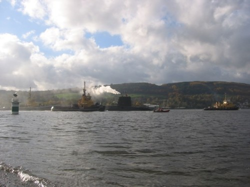 Trident being tugged to Faslane. Photo: Rebecca Johnson